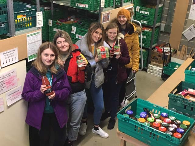 Students taking donations to Trussell Trust Foodbank